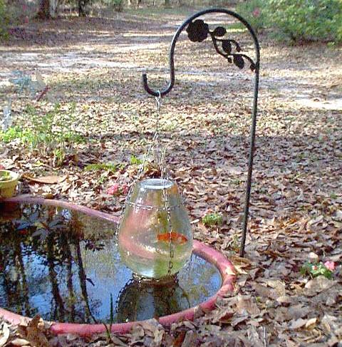 Diy hanging vase fish tower for Diy pond cleaner